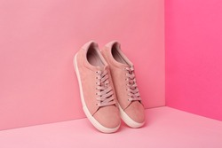 New comfortable sneakers with laces on color background
