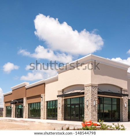 Shutterstock New Commercial, Retail and Office building Space available for sale or lease in mixed use Storefront and office building with awning
