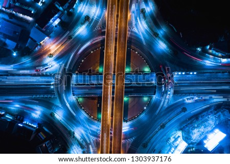new construction expressway and ring road industry connections the city for transportation and logistics business in Thailand at night long exposure shot over lighting car headlights movement