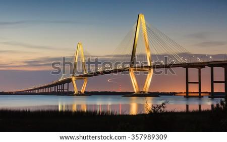 New Cooper River Ravenel Bridge in Charleston, South Carolina, illuminated at dusk. #357989309