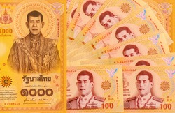 New currency of Thailand Baht 100 and 1000 Limited edition for The meaningful images reflecting the Royal Coronation Ceremony in 2019. Bangkok Thailand December 12, 2020. Thailand Baht Banknotes.