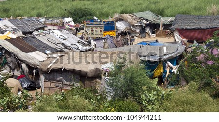 NEW DELHI, INDIA - AUGUST 3: Small slum near capital New Delhi on August 3, 2011 in India. Over 40 million Indian people live in slums.