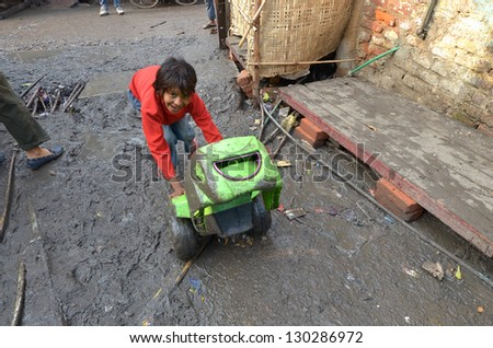 NEW DELHI,INDIA-FEBRUARY 4 :a  unidentified child playing the poorest district of New Delhi in February 4,2013 New Delhi dramatically increases the number of poor people living in slums