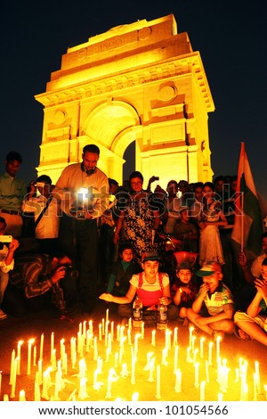 NEW DELHI, INDIA - MARCH 24: People comemorating war heroes in front of India Gate, New Delhi