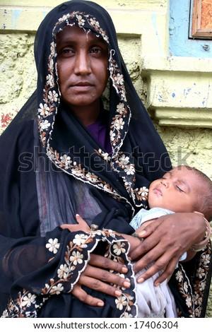 NEW DELHI, INDIA - Mother holding baby during religion celebration June 18, 2008 in New Delhi, India