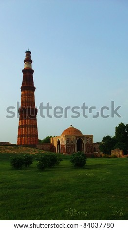 NEW DELHI - JULY 2: The Qutb Minar facade on July, 2, 2011 in New Delhi. The Qutb Minar is a tower located in Delhi, India and it is the world's tallest brick minaret with a height of 72.5 meters