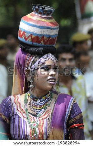 NEW DELHI-MAY 16:  A woman traditional dancer dancing to entertain the crowd  after  BJP party  won the the Indian National election on May 16, 2014 in New Delhi , India.