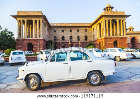 NEW DELHI - OCT 16: Official Hindustan Ambassador cars park outside North Block, Secretariat Building, on October 16, 2012 in Delhi, India. The production started in 1958 on base of the Morris model.
