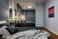 New design bedroom with bed, mirrored wardrobe and modern painting