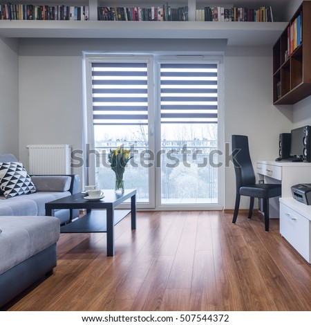 New design home interior with balcony, sofa and small table