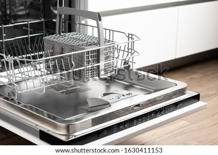 New dishwasher. Built-in dishwasher in kitchen