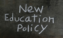 New Education Policy Phrase Written On Blackboard With White Chalk