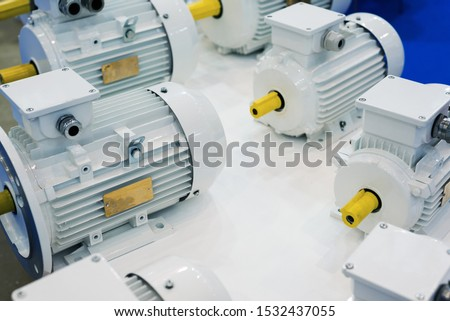 New electric motors. Electric motors are painted white. Modern drive equipment. #1532437055
