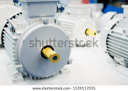 New electric motors. Electric motors are painted white. Modern drive equipment. #1539117035