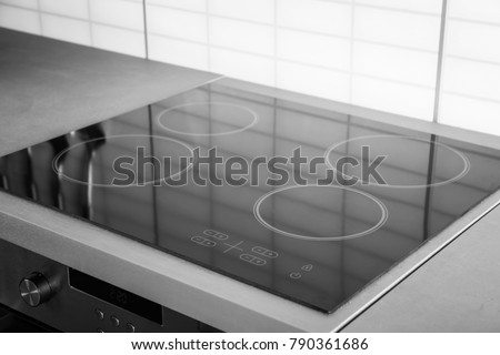 New electric stove with induction cooktop in kitchen, closeup