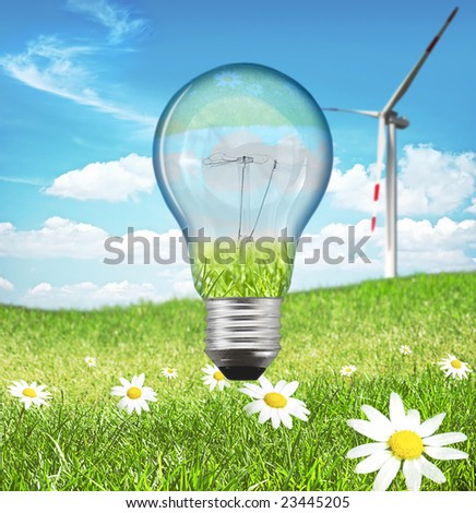 New energy concept. Bulb with green landscape