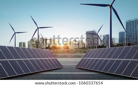 New energy, solar and wind power in the city at sunset #1060337654