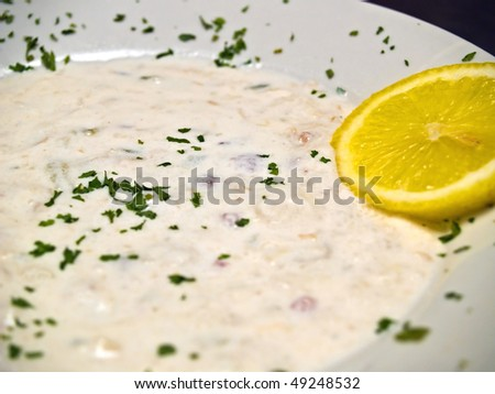 New England Clam Chowder in a Bowl with a Slice of Lemon