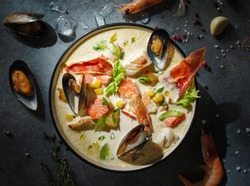 New England clam chowder, occasionally referred to as Boston or Boston-style Clam Chowder. Creamy soup with shrimp, corn, bacon and mussels.
