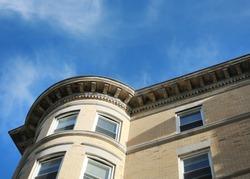 New England farmhouse architecture, apartments buildings on Beacon St.