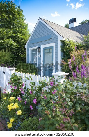 New England garden cottage - stock photo