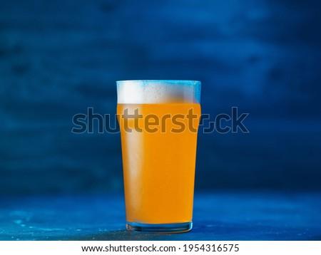 New England IPA craft beer glass on dark blue background Stok fotoğraf ©