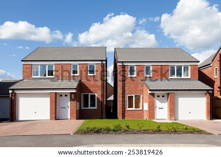 New english detached houses with garage