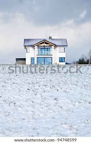 New family house in a winter meadow