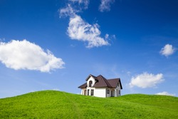 New family house on green field with blue sky