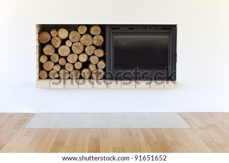 new fireplace with wooden logs