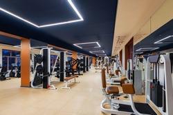 New fitness machines in modern gym interior