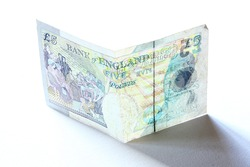 new five 5 pounds banknote greenback paper money with shadow