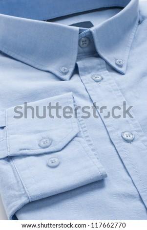 New folded blue men shirt, close-up macro