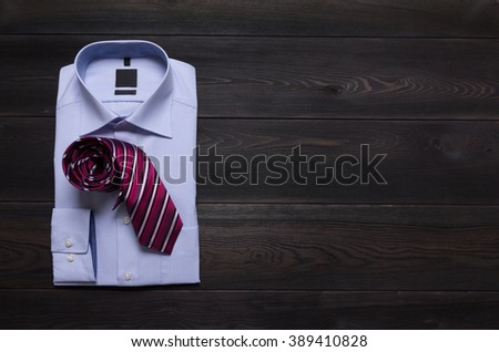 new folded business blue shirt and red tie. Man's formal wearing #389410828