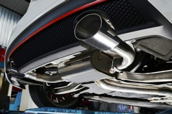 New generation of sportive mufflers. Double Car Exhaust Pipe chromed made of stainless steel. Close up.