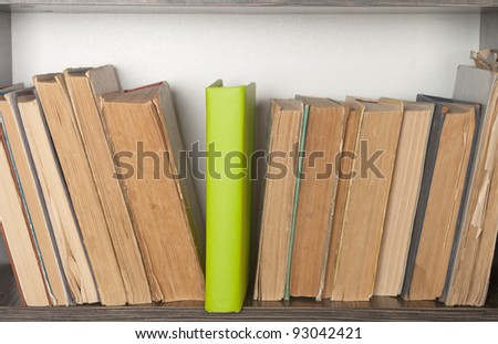 new green book of old books on the bookshelf - stock photo