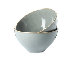 New grey ceramic bowls on white background
