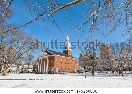 New Haven Green with snow and blue sky: a park in downtown New Haven, CT used for public events and bordered by Yale University. Stock Photo:
