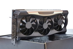 New high end graphics card computer hardware upgrade on a desk. Serious GPU cooling for high power card