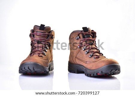 New hiking boots on white background