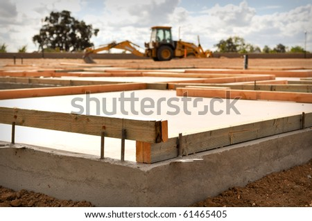 New Home Foundation with Tractor in Background