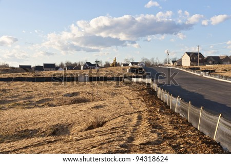 New house construction site with silt fence