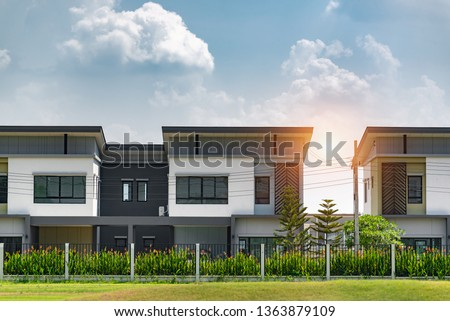New house for sale or rent on blue sky background. Real Estate concept,copy space,A row of new townhouses or condominiums.