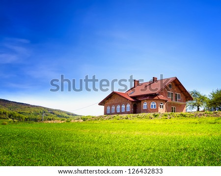 New house in the mountains - stock photo