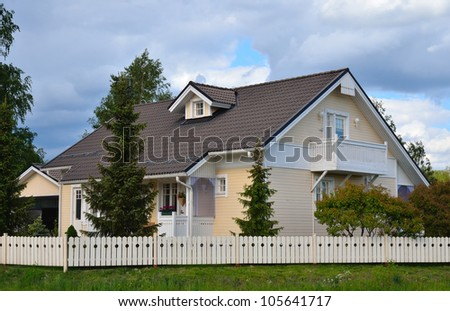 new house with a garden in the countryside