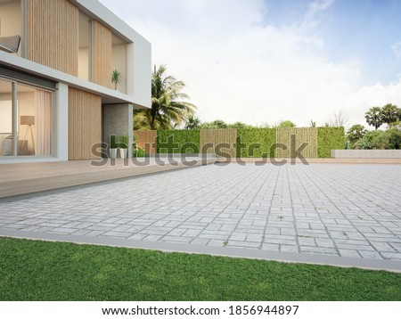 New house with empty cobblestone floor for car park. 3d rendering of green grass lawn in modern home.