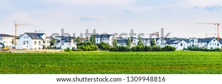 New houses, banner. Construction of new houses in a new residential area, Germany