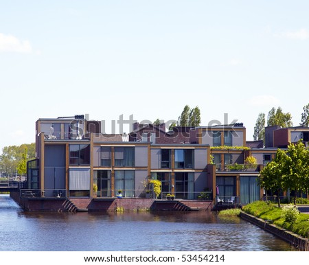 new houses with a blue sky - stock photo