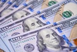 New hundred dollar bills stacked fan. Tilt-shift effect.