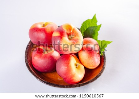 New hybrid sweet fruit nectarina platerina, flat Saturn or donut nectarine peaches close up